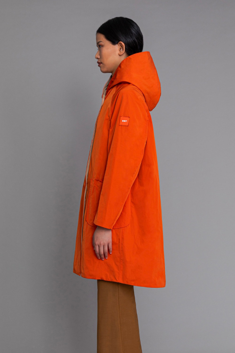 Reversible raincoat with hood in pumpkin and beige