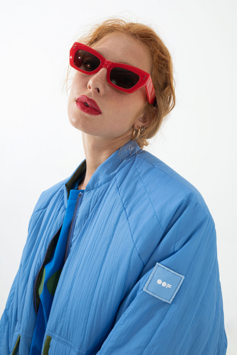 Women's padded reversible bomber jacket in sky blue and green