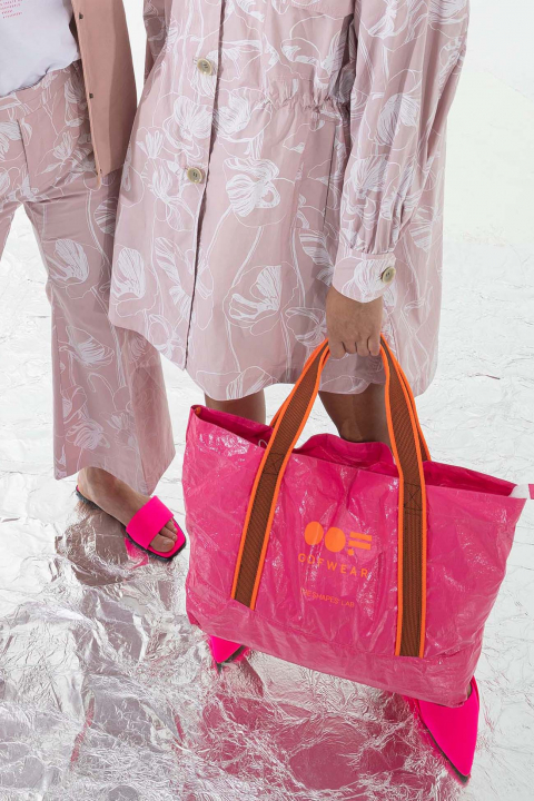 Glossy shopping bag with logo in fluorescent shocking pink