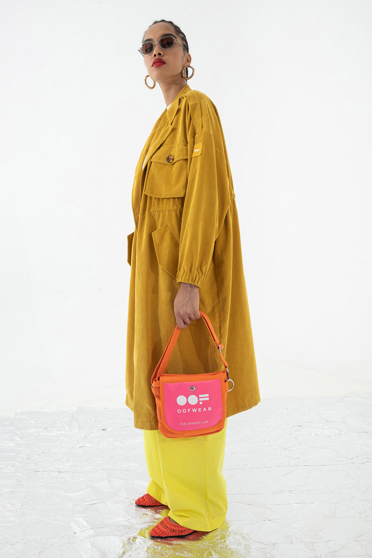 Women's long duster coat in yellow corduroy