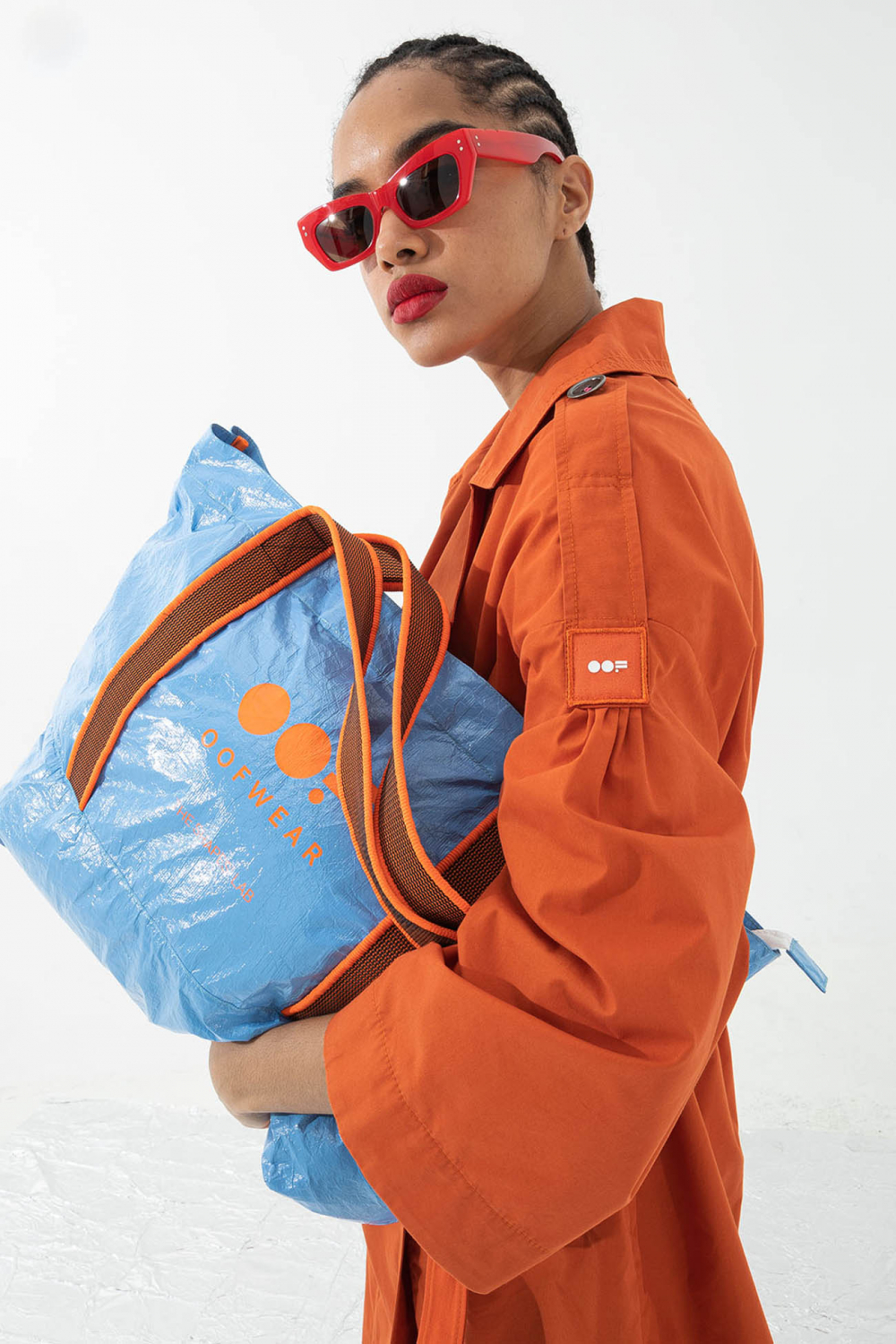 Glossy shopping bag with logo in sky blue