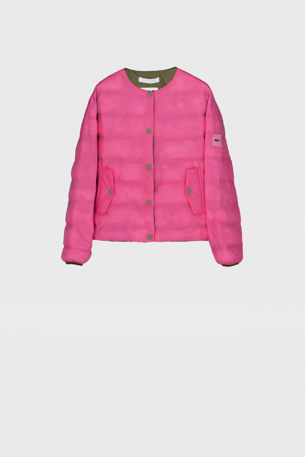 Short padded and reversible jacket in green and pink